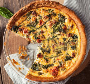 stock-photo-homemade-cheesy-egg-quiche-for-brunch-with-spinach-and-tomato-455548966